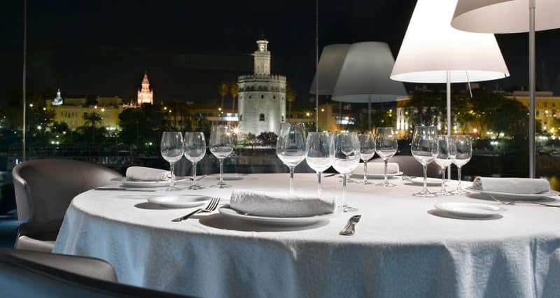 abades triana restaurant seville at night