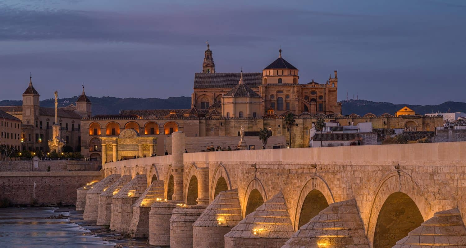roman bridge in cordoba at dusk