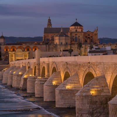 roman bridge cordoba at dusk