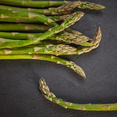 preparing asparagus on slate
