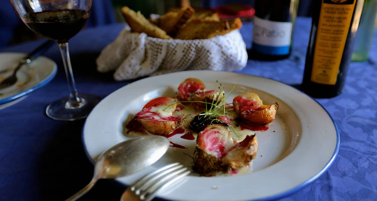 croquetas and wine on table