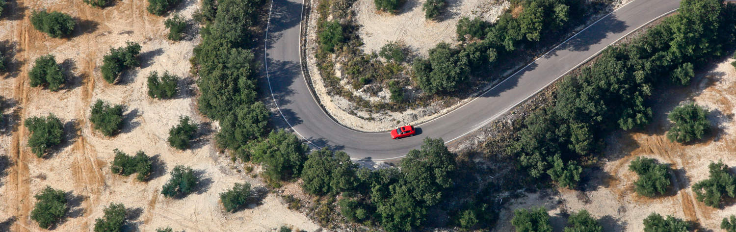 red audi driving through spanish hills Andalucia
