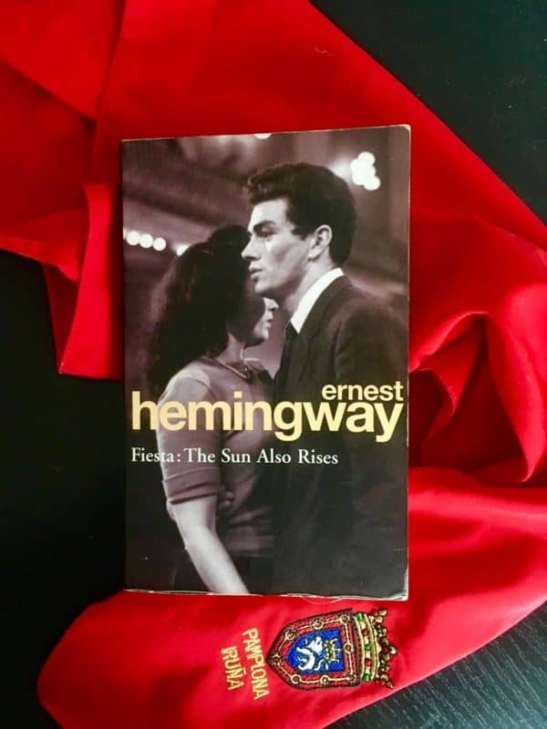 Hemingway book against red scarf