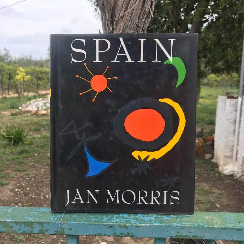 book about spain with field in background