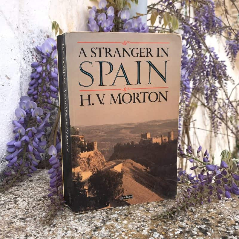Book about Spain with purple flowers